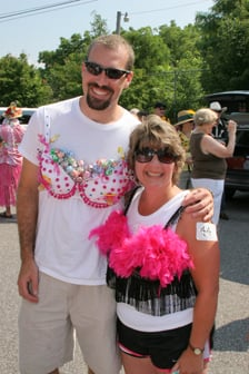 man and woman marching for breast cancer