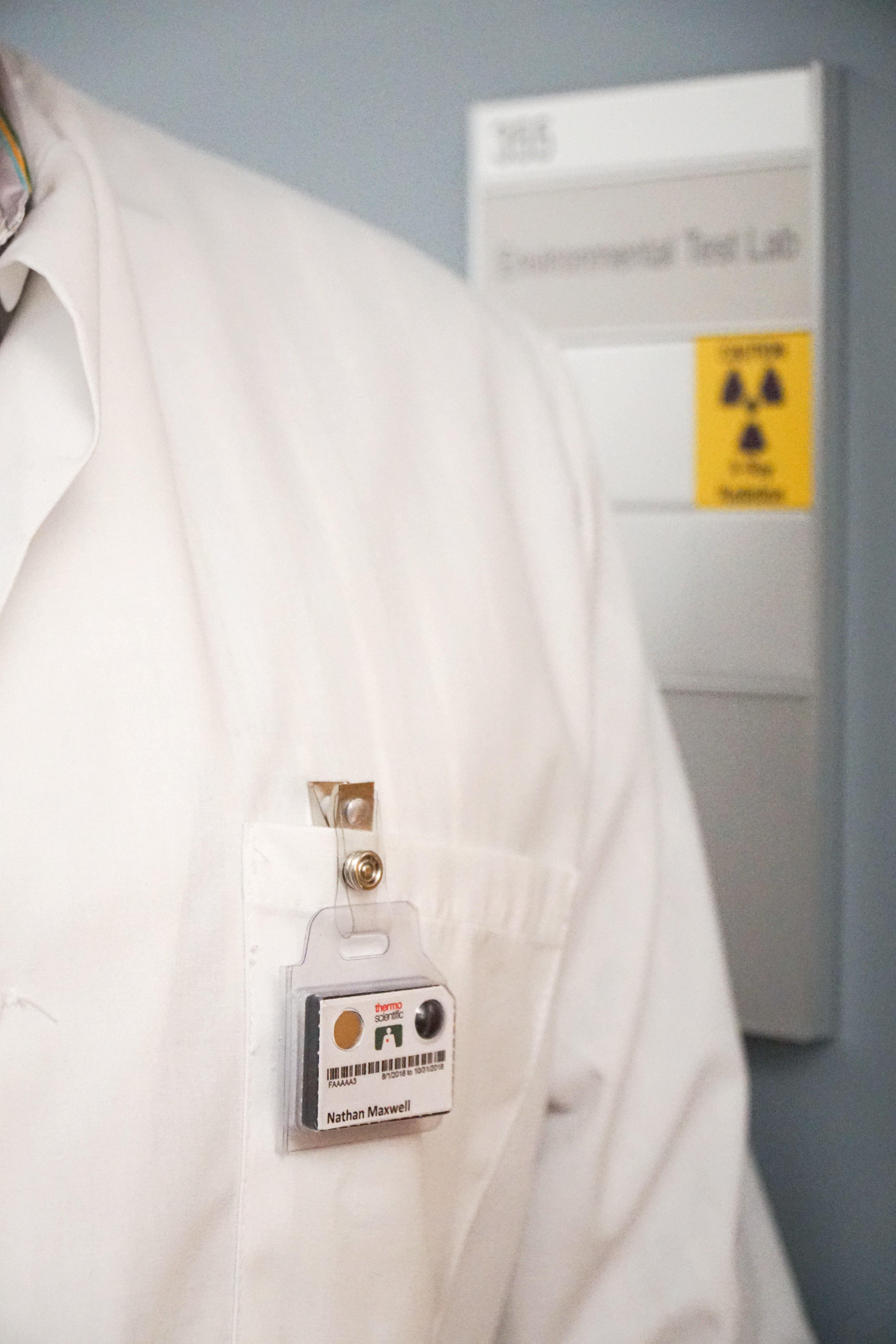 Wearing personal radiation measurement badges to measure dose exposure is crucial.