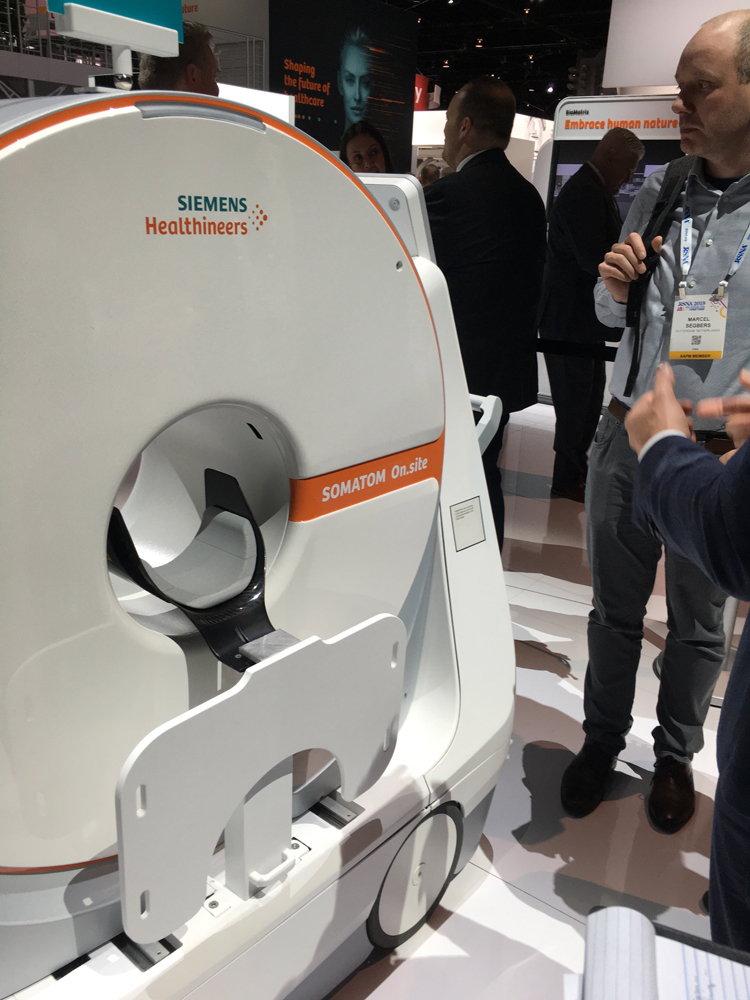 The 510k-pending Siemens Somatom On.site mobile CT scanner brings the system directly to the patient in the ICU. It features an integrated head rest and shoulder board, and moves to help position the head without moving the patient.