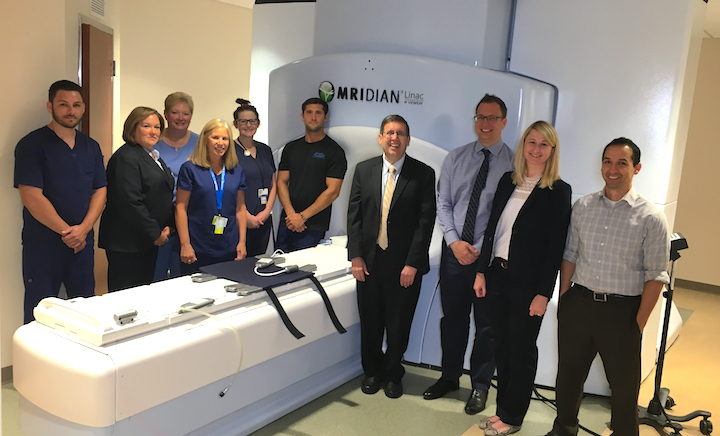 Henry Ford Hospital's ViewRay MRIdian linear accelerator system allows real-time MRI-guided radiotherapy. Shown is the support staff for this system. In the center of the photo is Benjamin Movsas, M.D., chair of radiation oncology at Henry Ford Cancer Institute. Second from the right is Carrie Glide-Hurst, Ph.D., director of translational research, radiation oncology.