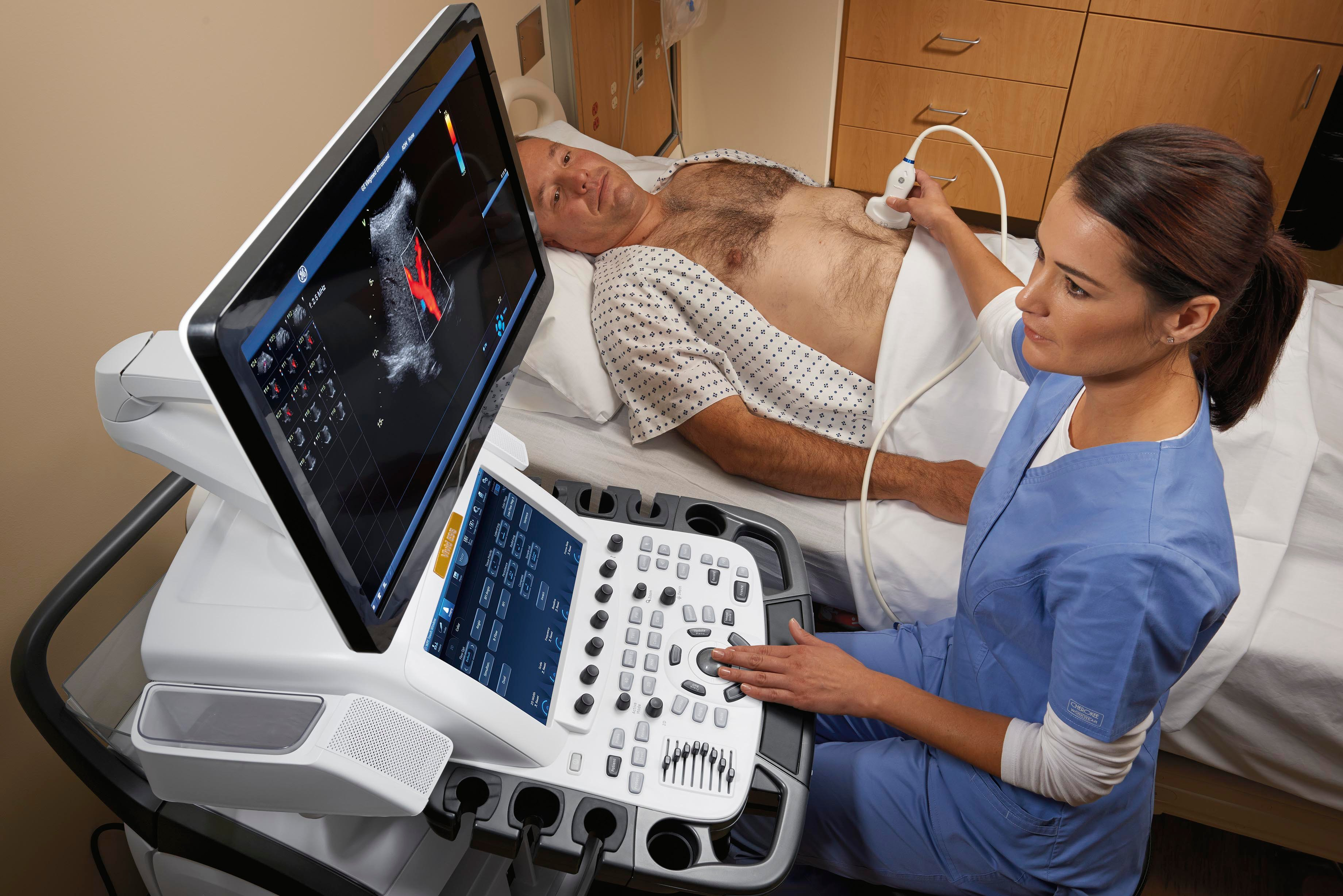 A sonographer performs an abdominal ultrasound exam with GE's Vivid E95 system