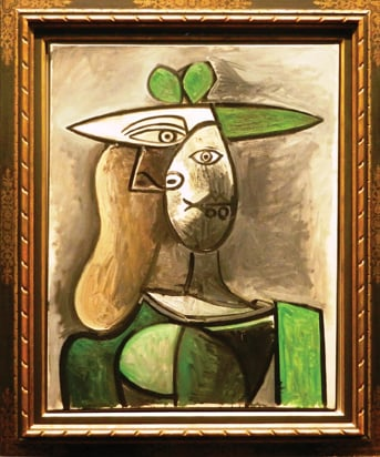 picasso woman with green hat.