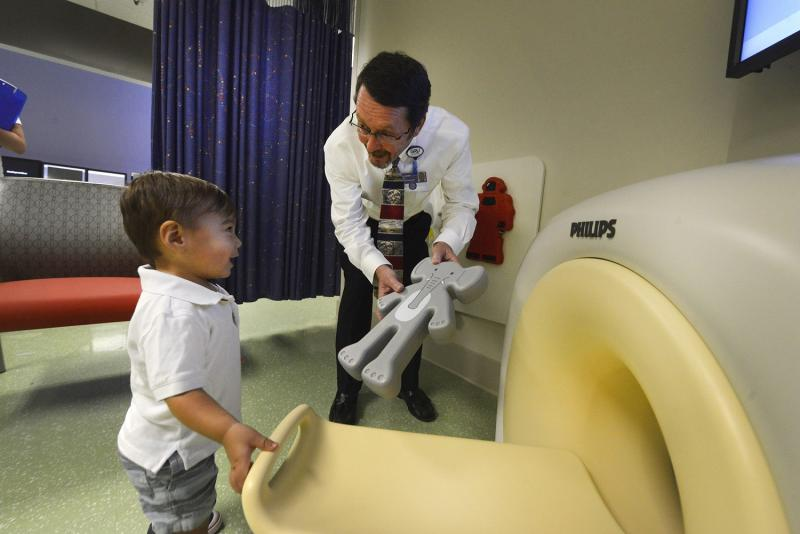 """Philips """"KittenScanner,"""" a miniature, simulated """"CAT scanner"""" at Children's Hospital of Georgia, calms pediatric patients by explaining what will happen during an actual CT exam"""