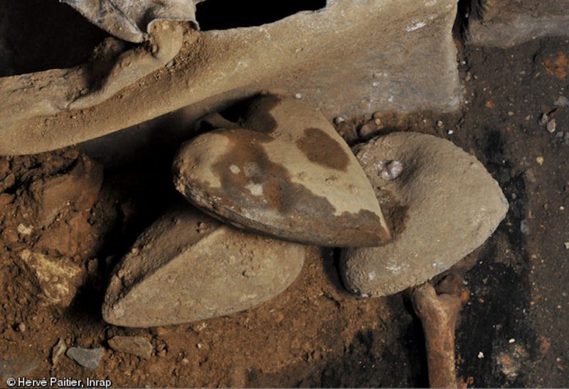 Archeological excavation of lead-preserved hearts in France.