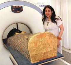 Dr Sahar Saleem placing the mummy in the CT scanner