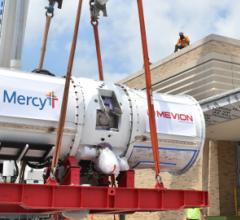 The 15-ton compact accelerator is lifted into the David C. Pratt Cancer Center at Mercy St. Louis. (Photo: Business Wire)