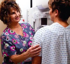 Diane Coady, R.T. (R)(M), breast center supervisor, talks to a patient about the 3D mammogram provided by Willamette Valley Medical Center.