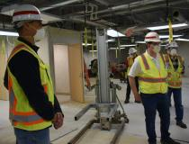 "On the site where the movie ""Contagion"" was shot in 2011 in Elgin, Illinois, the old hospital building is now being renovated into a real-life COVID-19 pandemic hospital. Lt. Col. Aaron Reisinger, commander of the Army Corps of Engineers, Chicago District, and Tom Nelson, from Turner Construction, speak with Maj. Gen. Robert Whittle, the deputy commander USACE, about construction progress of the Elgin COVID19 Alternate Care Facility in Elgin, April 3. The district, in support of FEMA and partnering with the"