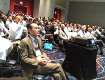 A standing room only crowd showing the level of interest interest in the new therapy concept of flash proton therapy. The idea is to deliver very high dose proton therapy in one dose so the patient does not have to return for additional fractions, which would enable better throughput and offer a convenience to the patient.